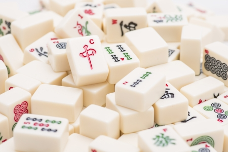 Closeup of asian Mah Jong board game pieces photo