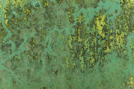 Grungy industrial metallic texture on stained sheet of metal photo