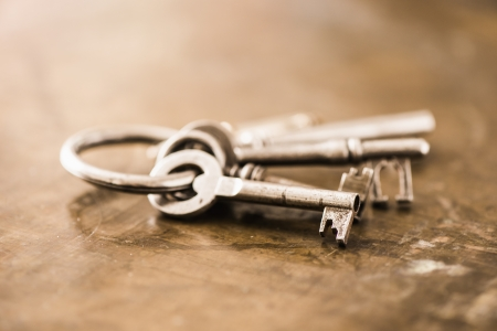 Close-up of a group of antique skeleton keys on wooden background photo