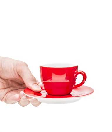 Closeup on white background of male hand serving red cup of coffee Stock Photo