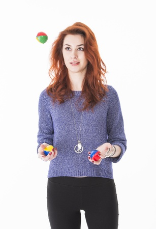 Portrait of attractive young woman holding juggling balls photo