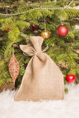 Christmas tree and holiday presents in a canvas bag Stock Photo