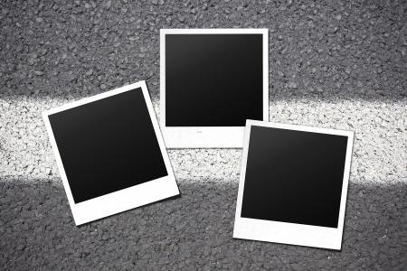 polaroids on asphalt Stock Photo