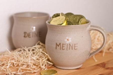 mug with gold Stock Photo