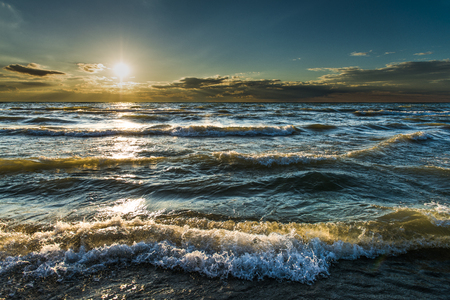 pinery: Waves, beautiful sunset, gold sunlight through blue turquoise water of Lake Huron, Pinery Provincial Park