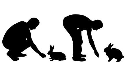 silueta masculina: Silhouettes of men feeding rabbits isolated on white