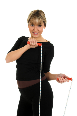 Young beautiful girl exercises with rope isolated on white background Stock Photo
