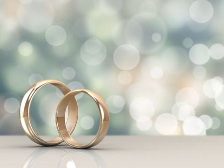 A pair of gold wedding rings with bokeh background 版權商用圖片 - 32656537