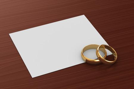 Ein Paar goldene Hochzeit Ringe und eine Karte Standard-Bild - 32656542