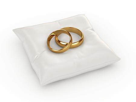 Ein Paar Goldhochzeitsringe auf einem Kissen Standard-Bild - 32712547