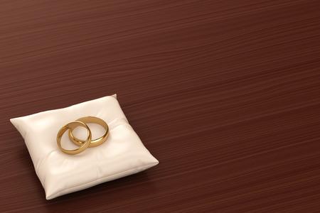 Ein Paar Goldhochzeitsringe auf einem Kissen Standard-Bild - 32712550