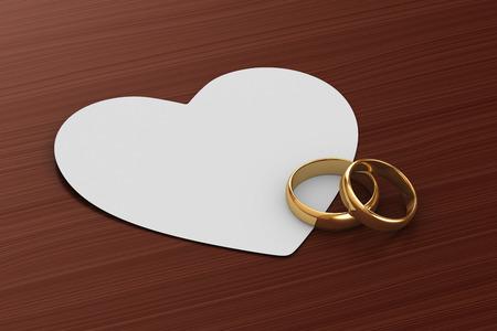 Ein Paar goldene Hochzeit Ringe und eine Karte Standard-Bild - 32712558