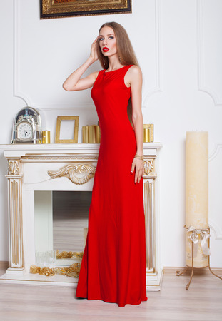 lady in red: Model with beautiful long hair posing in red dress