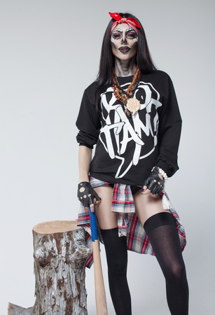 Hot beautiful sexy brunette model woman.Look zombie. Creative make up. Halloween concept.