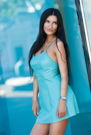 warm weather: Summer moment. Woman portrait outdoor. sunny warm weather day. Woman in dress walking in the city street