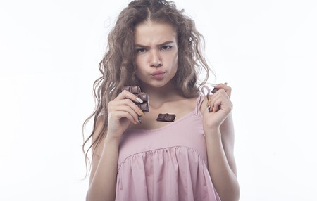 Portrait of a beautiful Woman eating chocolate.
