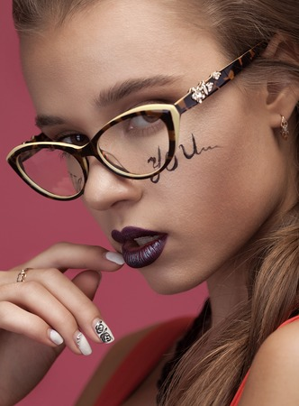 Sexy girl with glasses and creative make on face. Stock Photo