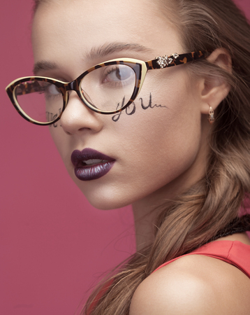 rigorous: Sexy girl with glasses and creative make on face. Stock Photo