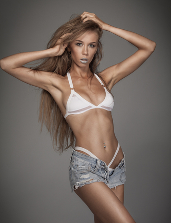 Beautiful woman body in denim jeans shorts and white lingerie