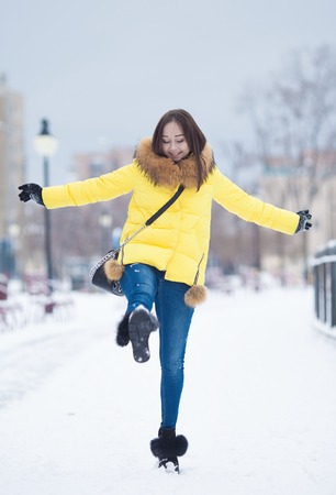 only 1 woman: Beautiful winter portrait of young woman in the winter snowy scenery. Beautiful girl in winter clothes. Young woman portrait. beauty girl on the blurred background Stock Photo