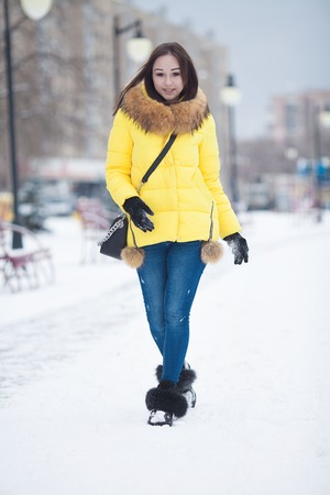 Beautiful winter portrait of young woman in the winter snowy scenery. Beautiful girl in winter clothes. Young woman portrait. beauty girl on the blurred background Stock Photo