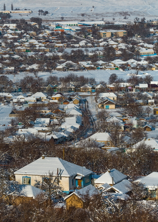 Winter village, houses in the snow. Good New Year spirit. Houses in the snow. View from above.