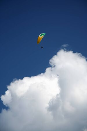 Paraglide on blue sky with clouds Imagens