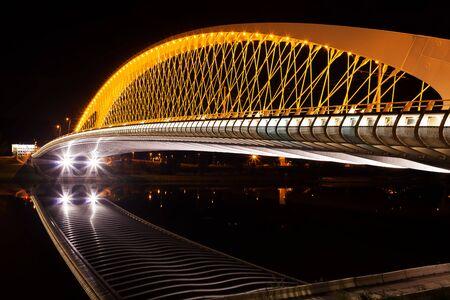 Modern bridge construction in night Imagens