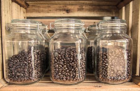 coffee bean in jar glass in wooden box