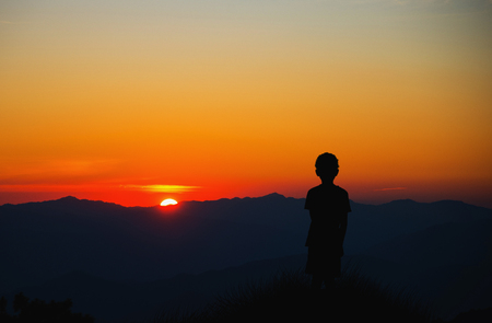 hardly: Abstract symbol idea. Where my parents, A lonely boy looking at sunset and think.... Stock Photo