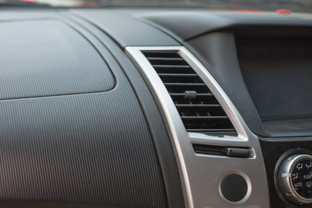 laceration: Car air conditioning system. Auto interior detail.