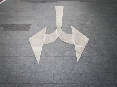 solutions freeway: White arrow on asphalt surface. Urban background.