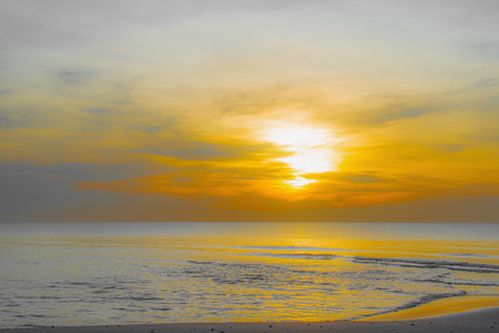 Sun sets over horizon of ocean. Sky, water and shore in the evening paint. soft effect Stock fotó