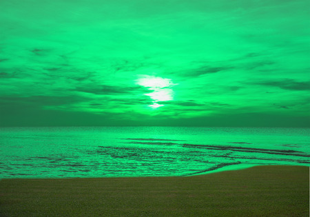 abstract idea green sea, sky, sunset and grass.