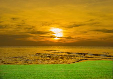 abstract idea orange sea, sky, sunset and green grass.