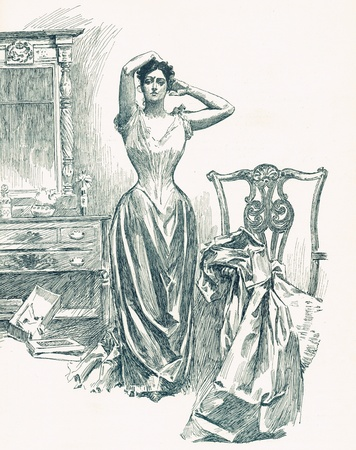 evening gown: Beautiful Victorian Woman in Corset is fixing her hair before putting on her evening gown for a ball  She looks sad but gorgeous,her small waist fitted in the fashion of the era   Stock Photo