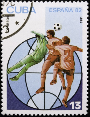 A stamp printed in Cuba shows football players, circa 1982