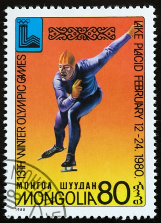 a stamp printed by mongolia shows slalom,13th winter olympic games symbol,lake placid,circa 1980