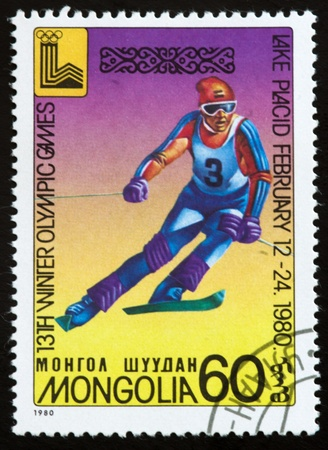 olympic symbol: a stamp printed by mongolia shows slalom,13th winter olympic games symbol,lake placid,circa 1980