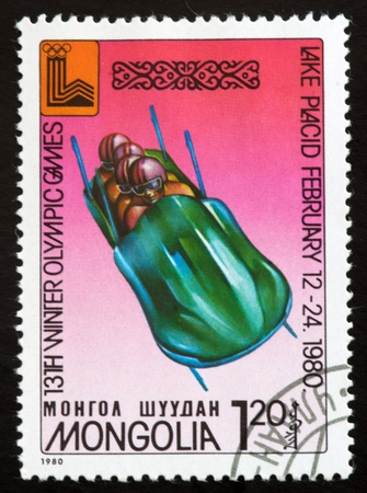 a stamp printed by mongolia show lake placid 80emblem,circa 1980