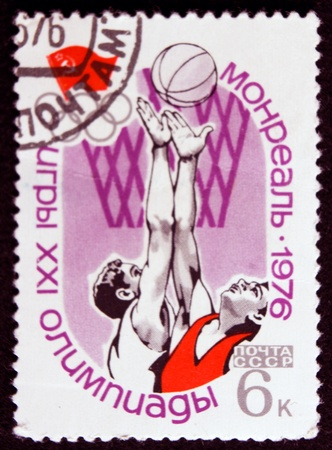 a stamp printed in the ussr shows basketball players,circa 1976 Editorial