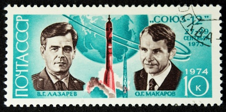 a stamp printed in the ussr shows the cosmonauts v.g.lazarev and o.g.makarov,and soyuz 12,circa 1974 Stock Photo