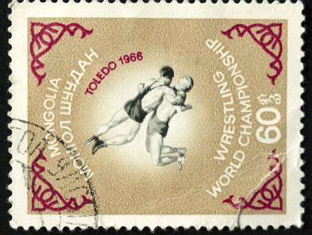 a post stamp printed in mongolia shows wrestling, circa 1966