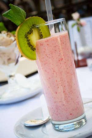 Fresh strawberry smoothie with kiwi