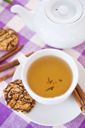 Cup of tea with biscuits photo