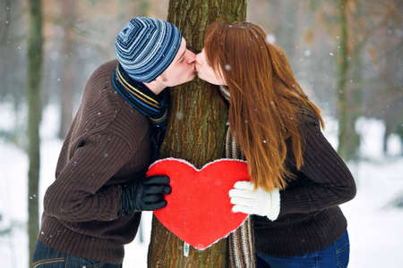 Couple with red heart smiling