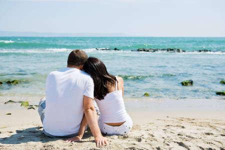 A couple sitting on beach Stock Photo - 6384828