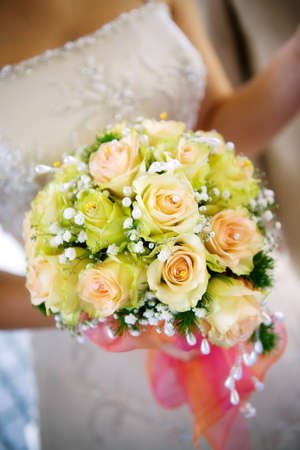 marriageable: Bridal bouquet in the hands of the bride Stock Photo