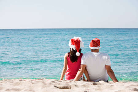 Christmas couple in love on the beach Stock Photo