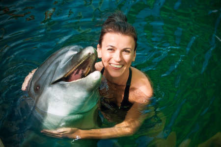 swimming animal: Girl and dolphin